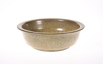 A CHINESE CELADON GLAZED BOWL, circular with everted