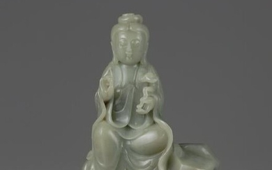 A CHINESE CELADON JADE CARVING OF A GUANYIN, CHINA