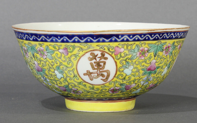 A Chinese Famille Rose yellow ground bowl