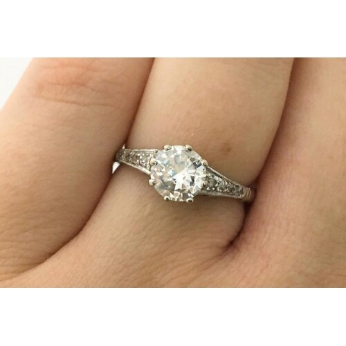 A DIAMOND SOLITAIRE RING, with round brilliant cut diamonds ...