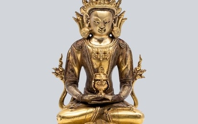 A Gilt Bronze Figure of Amitayus, China, 18th Century.
