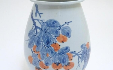A Japanese vase of ovoid form with hand painted