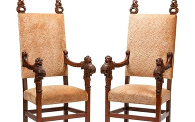 A Pair of Renaissance Style Carved Walnut Armchairs