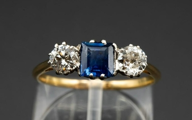 A SAPPHIRE AND DIAMOND RING, the square cut sapphire