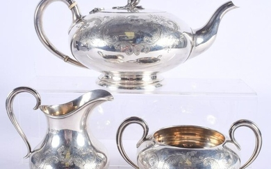 A VICTORIAN STYLE THREE PIECE SILVER TEASET. Sheffield