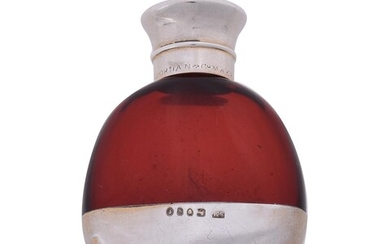 A Victorian silver mounted cranberry glass combination scent bottle and vinaigrette by S. Mordan & C
