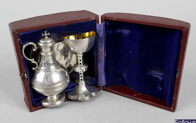 A Victorian silver travelling communion set.