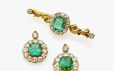 A brooch and a pair of earrings with emeralds and