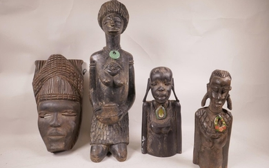 A collection of three African carved hardwood female figures...