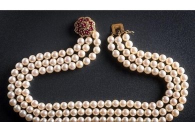 A cultured pearl three strand choker necklace with attached ...
