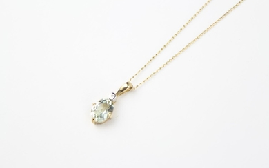 A ladies gold mounted aquamarine necklace, on a fine gold ch...