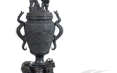 A massive bronze urn and cover