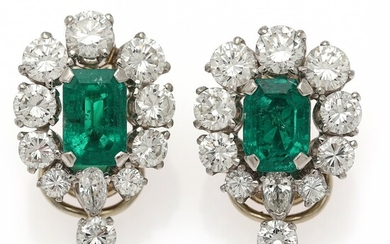 A pair of ear clips each set with an emerald encircled by numerous diamonds, mounted in platinum and 18k gold. (2)