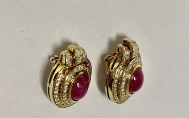 A pair of gold earring setted with center Rubi stone and diamonds