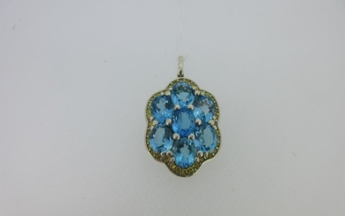A pendant set with a cluster of blue topaz and yellow