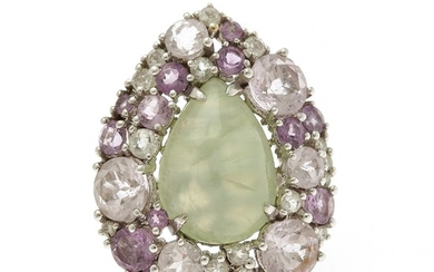 A prehnite and diamond ring set with a pear shaped prehnite encircled by numerous oval-cut amethysts and brilliant-cut diamonds.