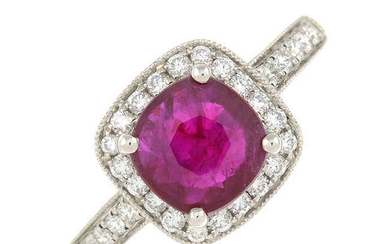 A ruby and brilliant-cut diamond cluster ring.