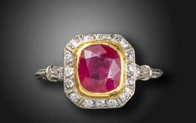 A ruby and diamond cluster ring, set with a cushion-shaped ruby within a surround of old circular-cut diamonds, with further circular-cut diamonds to the shoulders in platinum and gold, size N Accompanied by report number 2175695053 dated 18 July 2016...