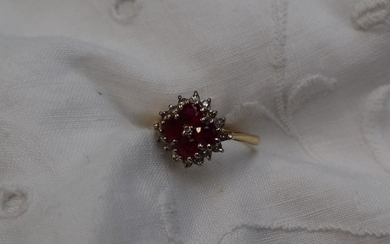 A ruby and diamond cluster ring, set with four...
