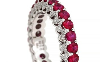 NOT SOLD. A ruby and diamond ring set with numerous rubies weighing a total of...
