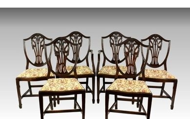 A set of six mahogany shield back dining chairs in the Georg...