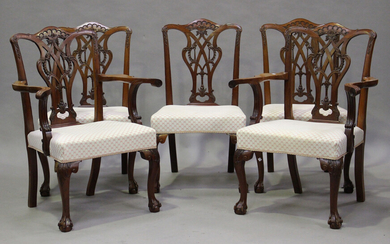 A set of ten 20th century George III style mahogany dining chairs, the finely carved pierced splat b