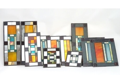 A suite of eleven Art Deco geometric stained glass window pa...