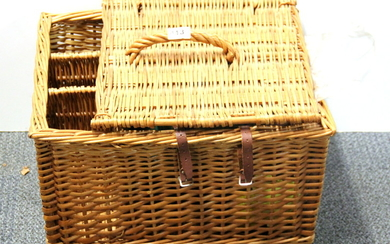 A vintage French picnic basket and picnic set.