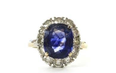A white gold sapphire and diamond oval cluster ring