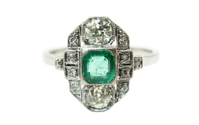 AN EMERALD AND DIAMOND DRESS RING The elongated plaque