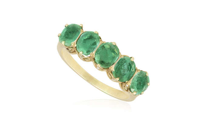 AN EMERALD FIVE-STONE RING Set with a graduated...