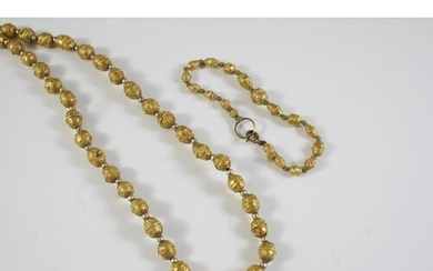 AN ETRUSCAN GOLD BEAD NECKLACE the oval-shaped beads with ap...