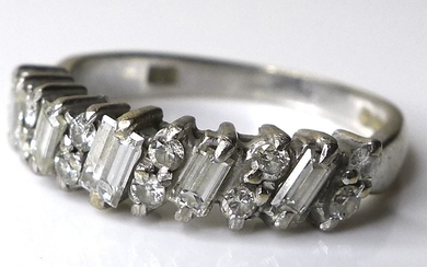 An 18ct white gold and diamond ring, five baguette cut stone...