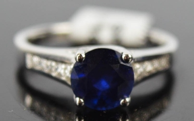 An 18ct white gold, blue sapphire and diamond ring, 1.8ct sa...