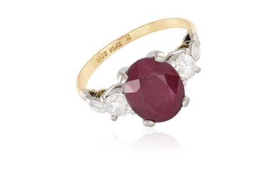 Description A RUBY AND DIAMOND DRESS RING, the oval-shaped...