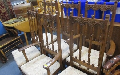 Four Ercol dining chairs and two matching carvers together w...