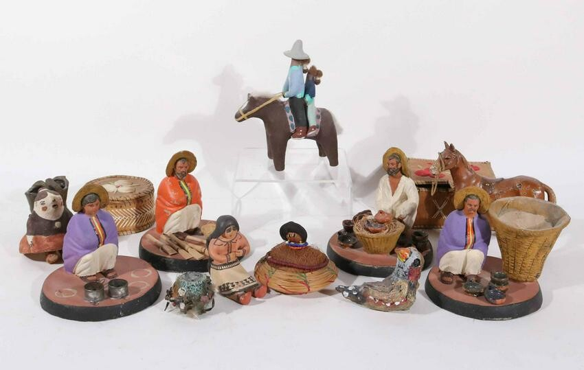 Four Southwestern Pottery Figures of Seated Men