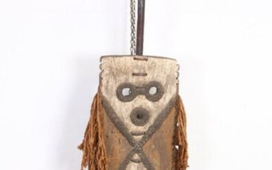Nigeria, hand mask in the shape of a...