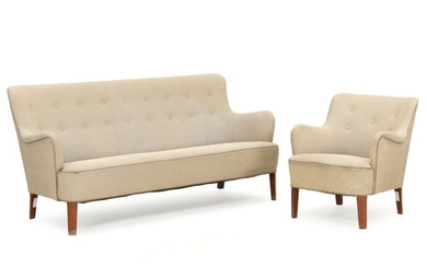 Orla Mølgaard-Nielsen: Three seater sofa and easy chair with stained beech legs. Upholstered with light coloured wool.
