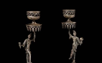 Pair of silver plated metal torches resting on a round openwork base, the was in the form of figures holding a parasol with mantling forming a bobbin. Work from the Far East, early twentieth century Height: 22.5 cm