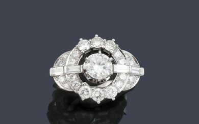 Ring with brilliant cut diamonds and baguette of