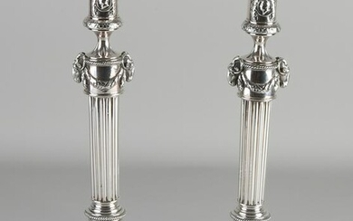 Set of capital silver candlesticks, Empire style, on a