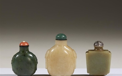Three Chinese carved jade snuff bottles Comprising a beige...