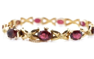 Tourmaline and 18ct yellow gold bracelet with approx nine 8x...