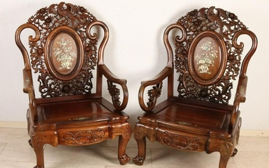 Two Chinese wood carved chairs with bird of paradise /