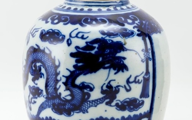 """UNDERGLAZE BLUE AND WHITE PORCELAIN JAR Decorated with dragons guarding a temple door. No cover. Height 10.5""""."""