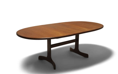 VICTOR WILKINS An oval teak extending dining table...