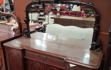 Victorian Carved Mahogany Breakfront Sideboard, with mirror back surmounted by eagle, centre drawer & four arched panel doors
