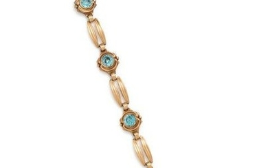 YELLOW GOLD AND BLUE ZIRCON BRACELET