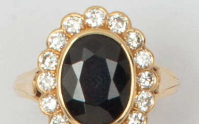 Yellow gold ring set with an oval faceted...